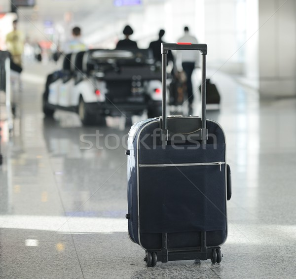 Bag of luggage on airport as travel symbol Stock photo © zurijeta
