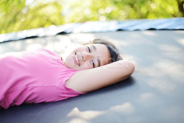 Portret glimlachend meisje trampoline groen gras meisje Stockfoto © zurijeta