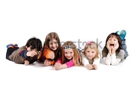 Children group family laying isolated Stock photo © zurijeta