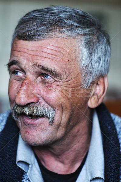 Common elderly positive man with mustache Stock photo © zurijeta
