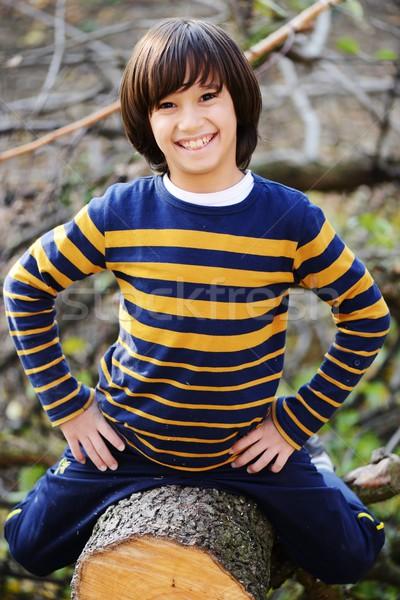 Boy portrait on tree outdoor in nature Stock photo © zurijeta