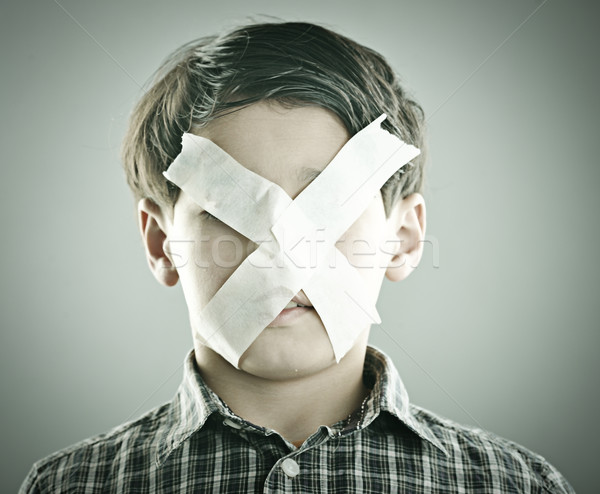 Portrait of kid with x shape on his face Stock photo © zurijeta