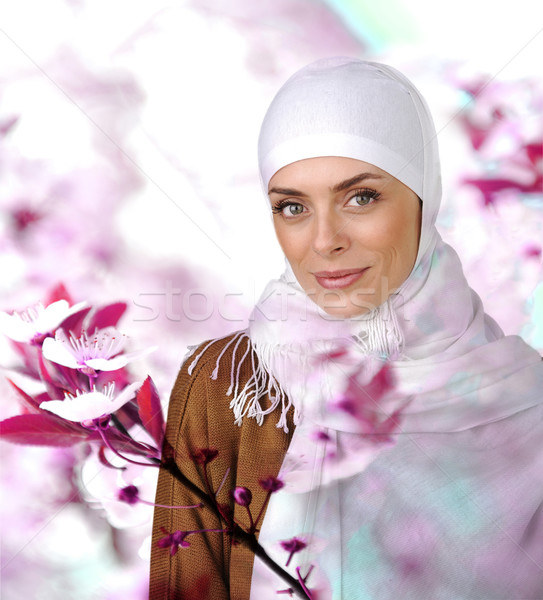 Beautiful Muslim positive woman smiling portrait Stock photo © zurijeta