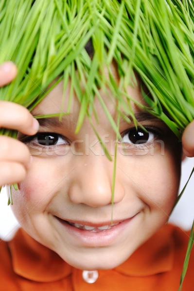 Cute happy kid with grass hair Stock photo © zurijeta