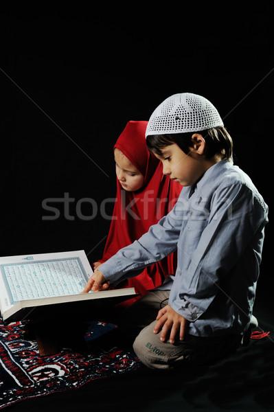 Muslim kids reading holy koran on black background Stock photo © zurijeta
