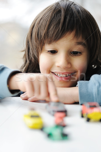 Innocence, childhood concept - playing with toy car Stock photo © zurijeta