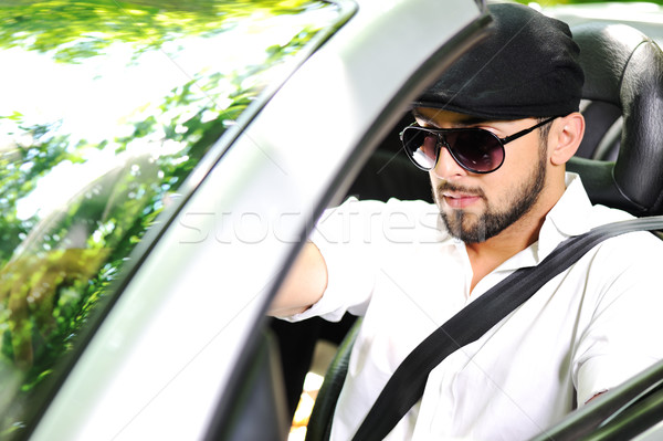 Young man driving a car with Stock photo © zurijeta