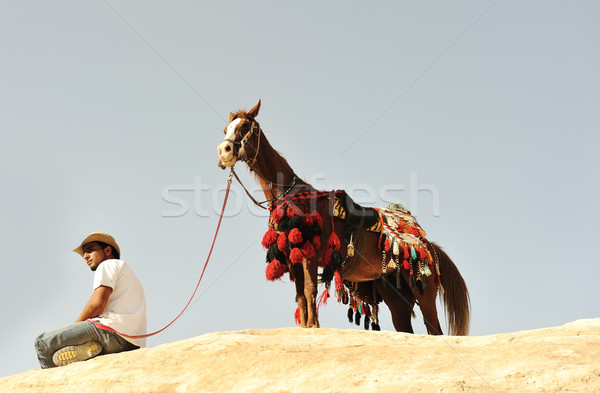 Man with a horse in asian mountains Stock photo © zurijeta