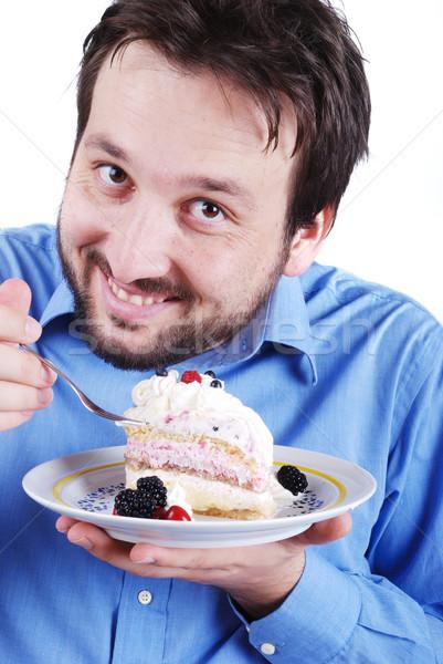 ストックフォト: 若い男 · 食べ · ケーキ · 食品 · 笑顔 · 歳の誕生日