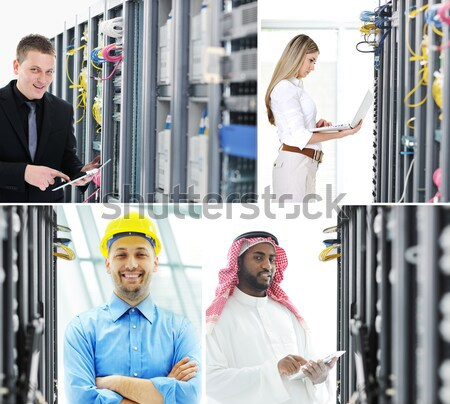 Confident technicians working in server room data center Stock photo © zurijeta