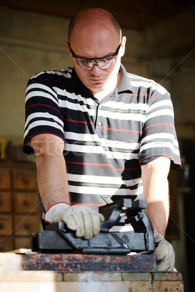 Craft worker working at workshop Stock photo © zurijeta