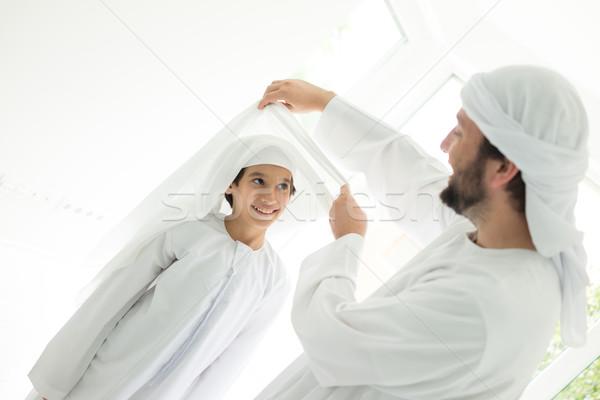 Happy Arabic father making headscarf to his son Stock photo © zurijeta