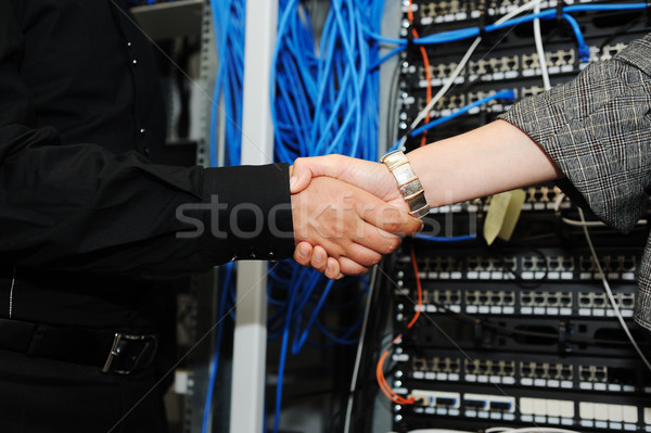 Handshaking at server room, man and woman Stock photo © zurijeta