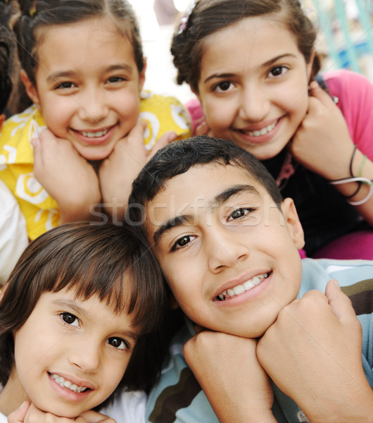 Vertical photo of children group, four friends smiling outdoor, boys and girls closeup Stock photo © zurijeta