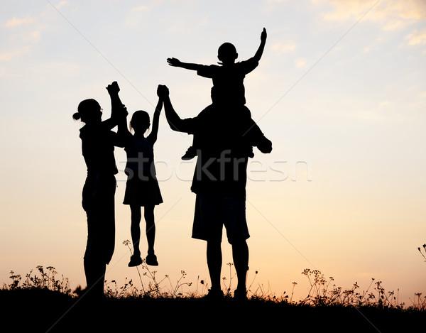 Sylwetka szczęśliwy dzieci matka ojciec rodziny Zdjęcia stock © zurijeta