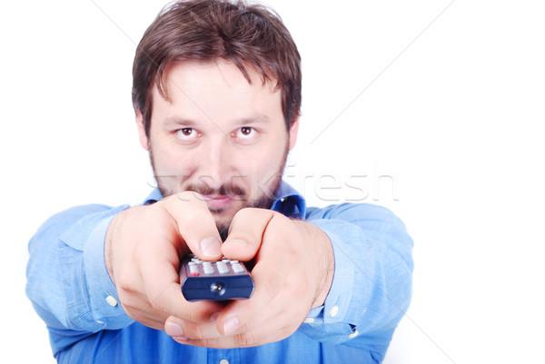 Homme télécommande souriant jeune homme mains main Photo stock © zurijeta