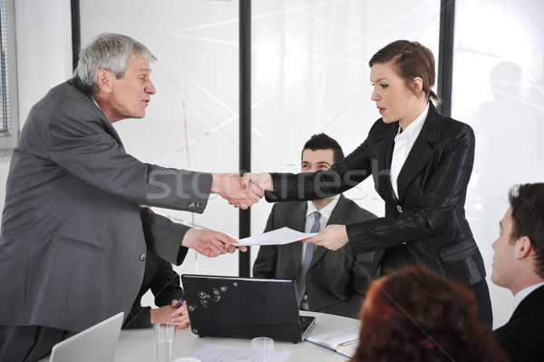 Happy business leaders handshaking at meeting Stock photo © zurijeta