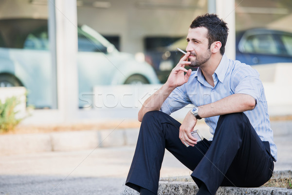 Well dressed man smoking Stock photo © zurijeta
