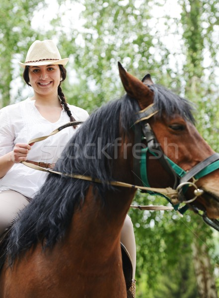 Image of happy female sitting on horse at village farm Stock photo © zurijeta