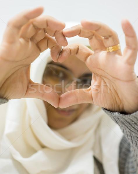 Muslim Arabic woman with heart shaped love symbol hands Stock photo © zurijeta