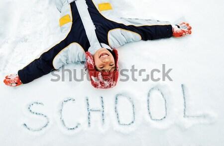 Pequeño nino mentiras invierno nieve ángel Foto stock © zurijeta