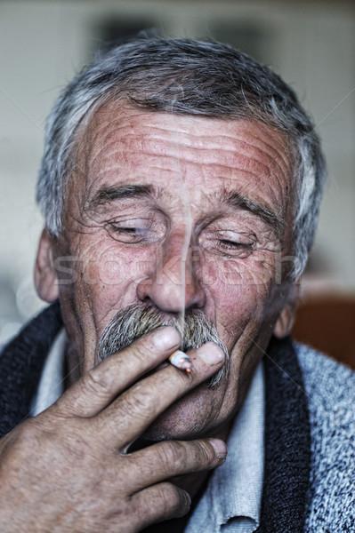 Starszych człowiek wąsy palenia papierosów twarz Zdjęcia stock © zurijeta