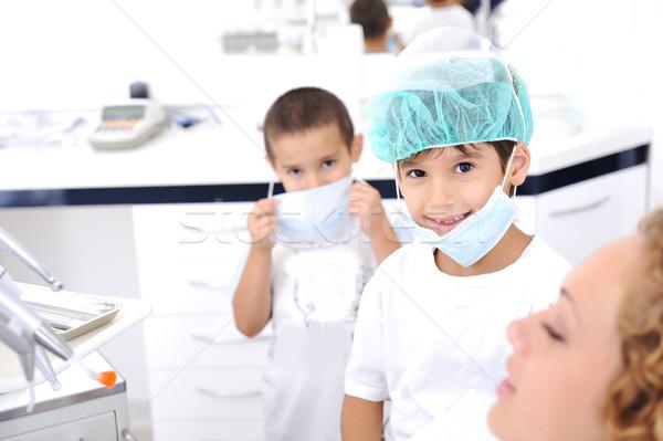Kid Dentist's teeth checkup, series of related photos Stock photo © zurijeta