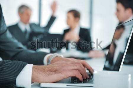 üzletemberek megbeszélés tárgyalóterem üzlet nő iroda Stock fotó © zurijeta