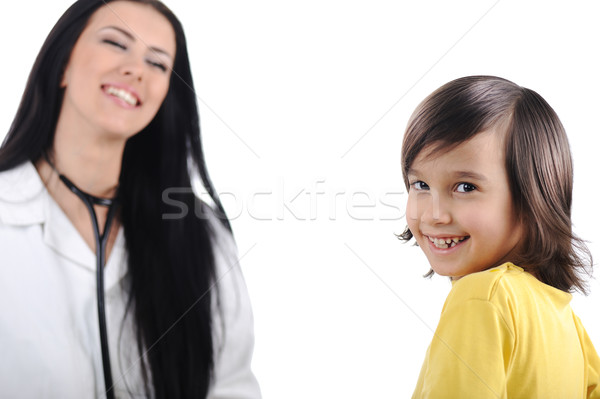 Young female doctor examining little cute child at modern hospital Stock photo © zurijeta