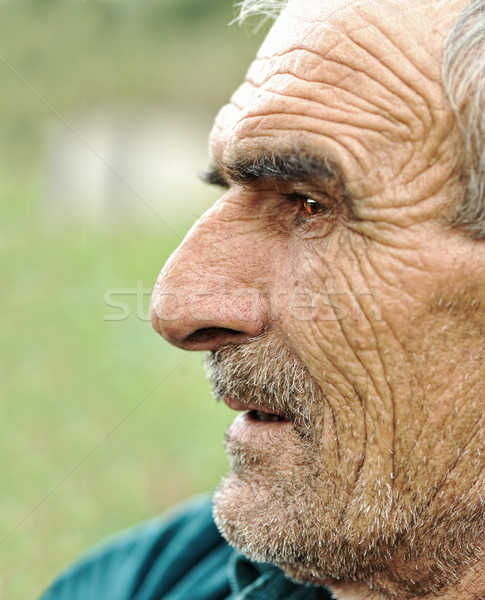 Senior man looking off into distance Stock photo © zurijeta