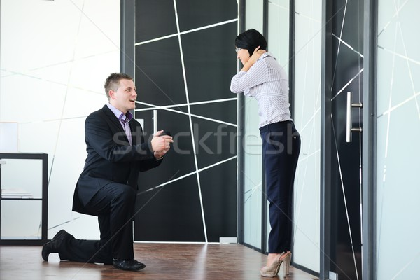 Young man romantically proposing to girlfriend and offering enga Stock photo © zurijeta