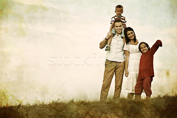 Filtered colorized image of a happy family in nature having fun Stock photo © zurijeta