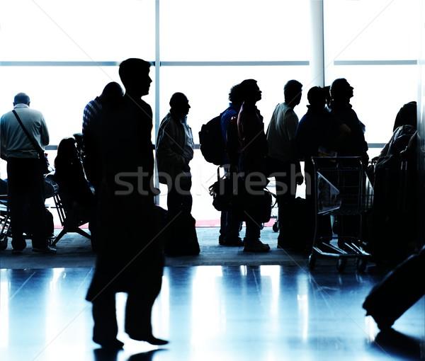 People silhouettes traveling on airport Stock photo © zurijeta