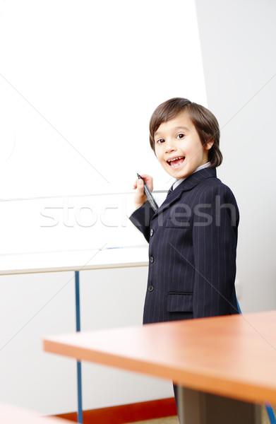 Genius boy making a  presentation  Stock photo © zurijeta