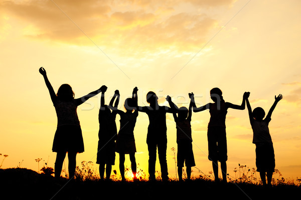 Group of happy children playing at summer sunset in nature Stock photo © zurijeta