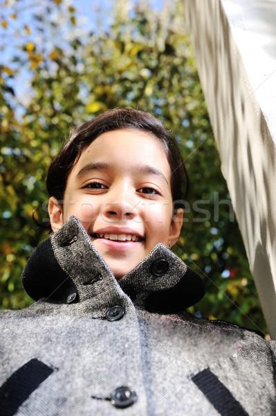 Boldog gyerek őszi levelek park kéz fal Stock fotó © zurijeta