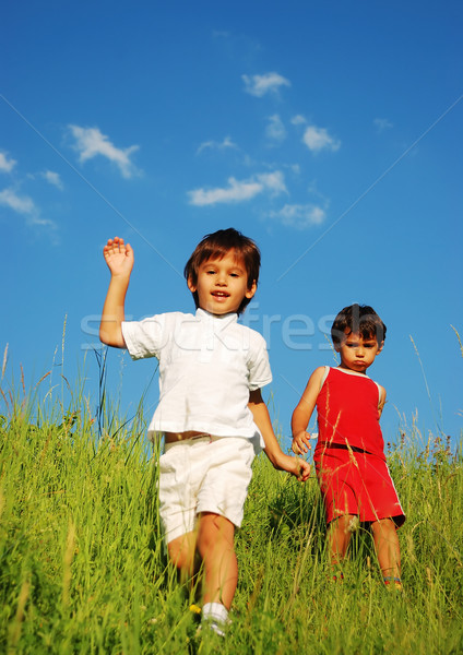 Stock photo: Happy unforgetable childhood on green meadow against blue sky