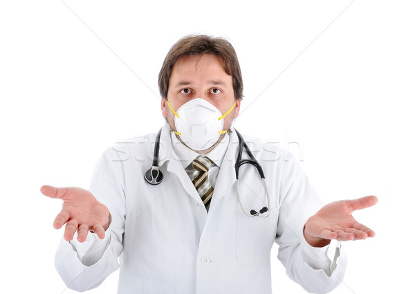 Young male doctor with a mask isolated Stock photo © zurijeta