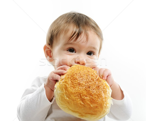 Baby eating bun bread Stock photo © zurijeta