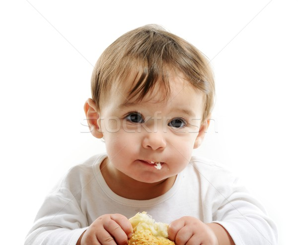 Baby eating bun bread Stock photo © zurijeta