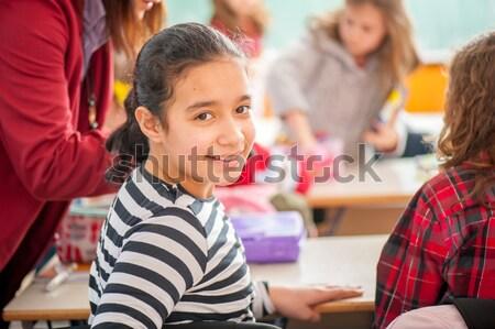 Aranyos iskolások osztályterem oktatás tevékenységek lány Stock fotó © zurijeta