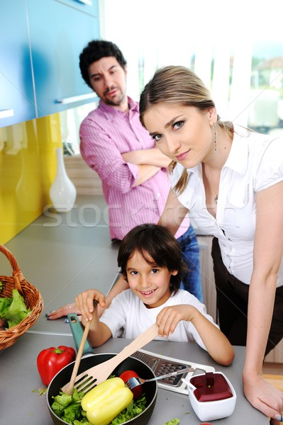 Happy family in the kitchen cooking dinner together Stock photo © zurijeta