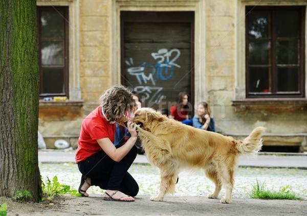Jovem pessoas reais rua cão urbano elegante Foto stock © zurijeta