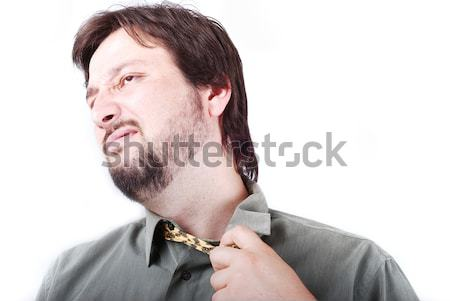 Stock photo: Man wearing shirt and tie with boring expression on his face