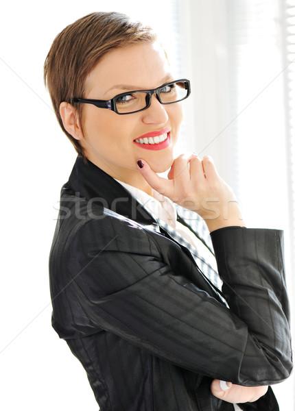 Beautiful business woman with short hair and glasses Stock photo © zurijeta