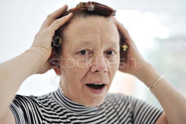 Senior lady with curlers on hair Stock photo © zurijeta