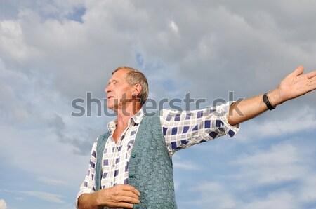 Senior male person making gestures Stock photo © zurijeta