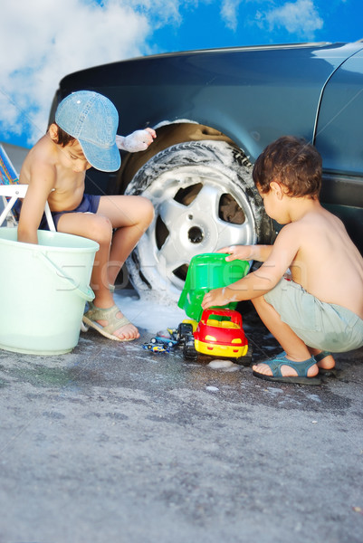 Child washing car and toy car Stock photo © zurijeta