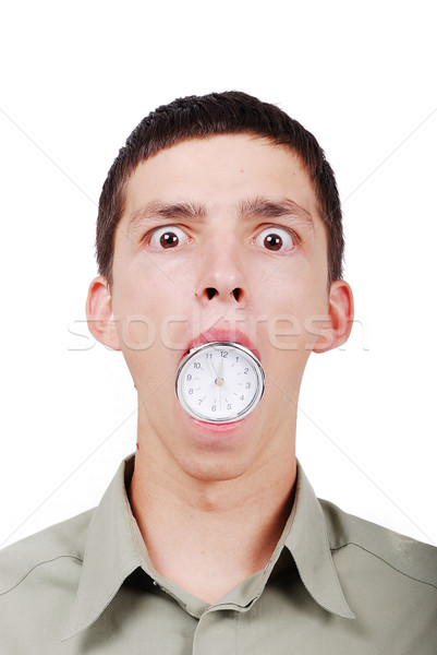 Young man with a watch in his mouth Stock photo © zurijeta