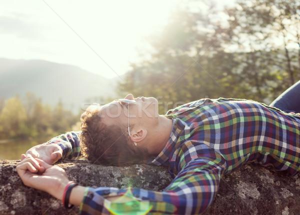 Młody człowiek starych kamień most kierować światło słoneczne Zdjęcia stock © zurijeta